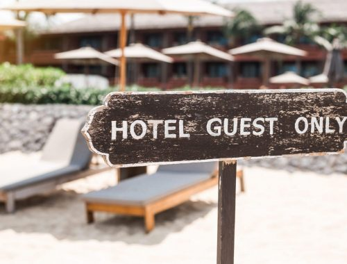 Hotel guest only sign, private property, hotel on a tropical island, limited access, luxury apartments, bassen, beach, chaise lounges